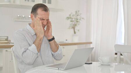 Stressed Middle Aged Man having Headache at Home 免版税图像 - 149610431