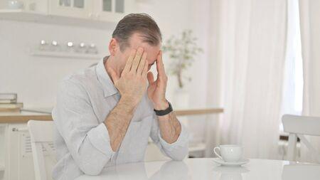 Headache, Tense Middle Aged Man Sitting at Home