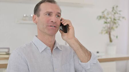 Negotiation, Middle Aged Man Talking on Phone