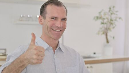 Portrait of Positive Middle Aged Man with Thumbs Up