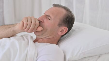Coughing Sick Middle Aged Man Sleeping in Bed