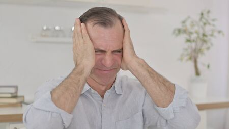 Portrait of Disappointed Middle Aged Man reacting to Loss
