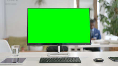 Close Up of Desktop with Green Chroma Key Screen