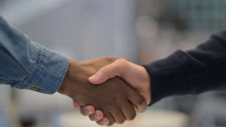 African Man and Caucasian Man Shaking Hands, Close Up