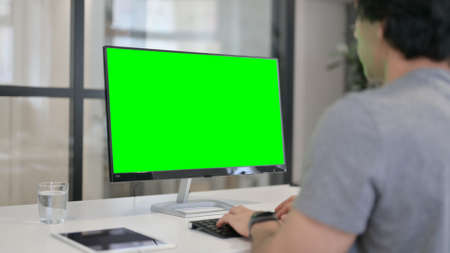 Businessman Using Desktop with Green Chroma Key Screen