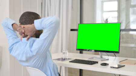 Businessman Resting While Using Desktop with Green Chroma Key Screen
