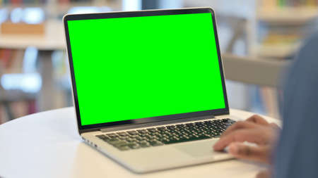 Man Using Laptop with Green Chroma Key Screen, Rear View Standard-Bild