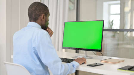 Businessman Celebrating While Using Desktop with Green Chroma Key Screen