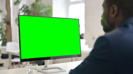 Man Using Desktop with Green Chroma Key Screen