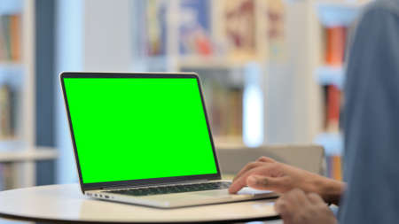 Male Hands Using Laptop with Green Chroma Key Screen, Close Up