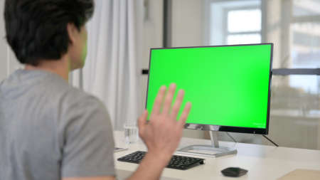Video Call by Businessman on Desktop with Green Chroma Key Screen, Zdjęcie Seryjne