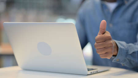 Man Working on Laptop and Showing Thumbs Up Sign, Close Up