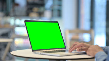 Man Using Laptop with Green Chroma Key Screen, Close Up