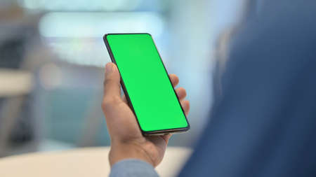 Smartphone with Green Chroma Key Screen in African Hands