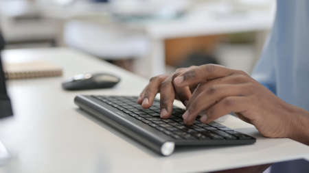 Hands of African Man Typing on Keyboard, Close Up