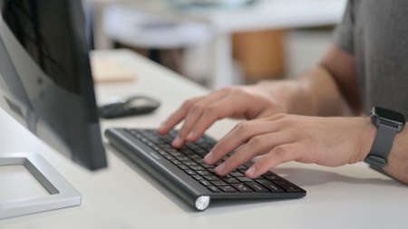 Hands of Young Man Typing on Keyboard, Close Up