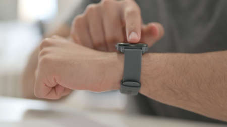 Hands of Young Man Using Smartwatch, Close Up