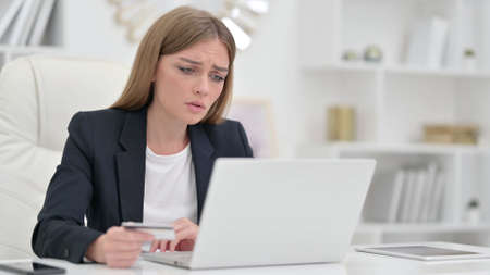 Unsuccessful Online Payment on Laptop in Office Stock Photo