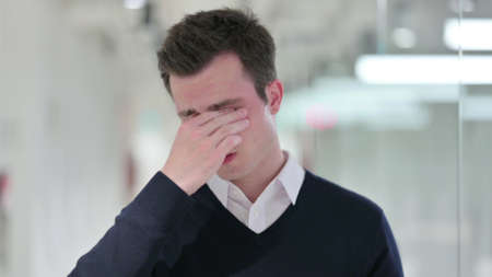 Exhausted Young Businessman Rubbing Eyes, Tired