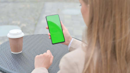 Businesswoman Holding Smartphone with Green Chroma Screen Outdoor 스톡 콘텐츠
