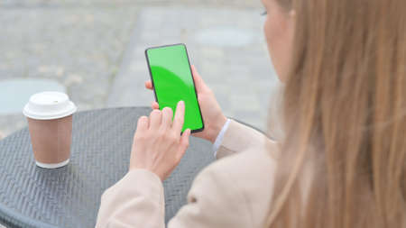 Businesswoman using Smartphone with Green Chroma Screen Outdoor 스톡 콘텐츠