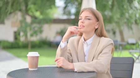 Businesswoman Thinking in Outdoor Cafe