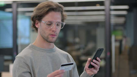 Online Payment on Smartphone by Young Man 스톡 콘텐츠