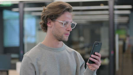 Portrait of Young Man using Smartphone