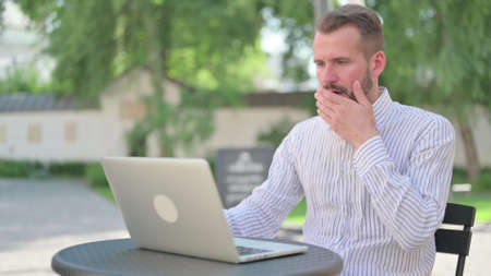 Mature Adult Man with Laptop having Loss, Failure