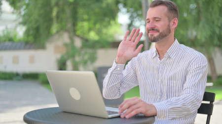 Mature Adult Man Talking on Video Call on Laptop 스톡 콘텐츠