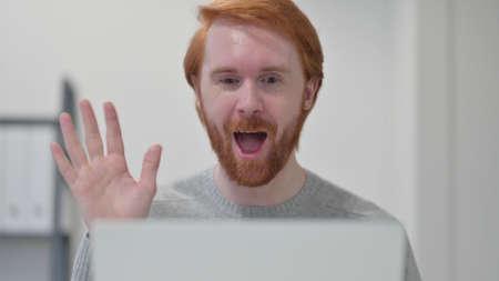 Beard Redhead Man doing Video Chat on Laptop 스톡 콘텐츠