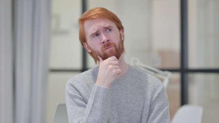 Pensive Young Beard Redhead Man Thinking 스톡 콘텐츠