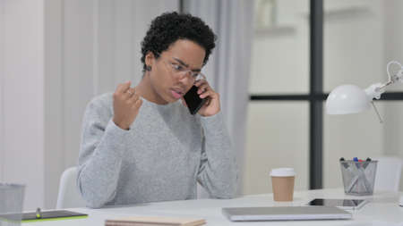 Angry African Woman Talking on Smartphone