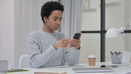 African Woman using Smartphone at Work