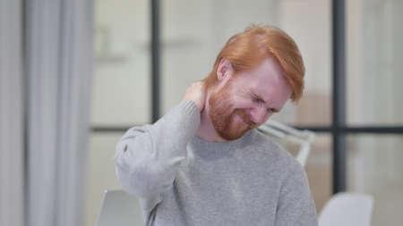 Young Beard Redhead Man having Neck Pain 스톡 콘텐츠