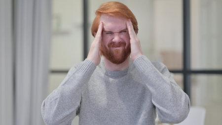 Young Beard Redhead Man having Headache 스톡 콘텐츠