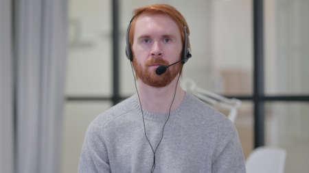 Young Beard Redhead Man Wearing Headset with Mic