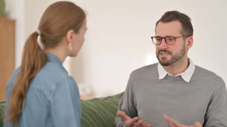 Man Arguing with Woman at Home