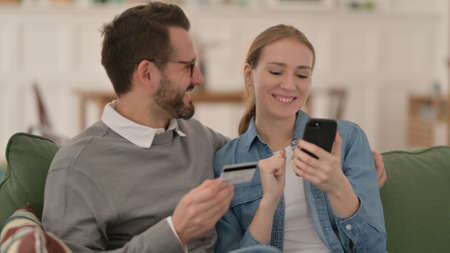 Couple making Online Shopping Payment on Smartphone