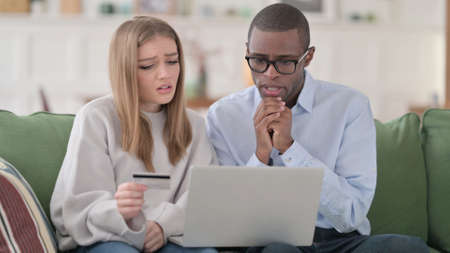 Online Shopping Payment Failure on Laptop by Interracial Couple