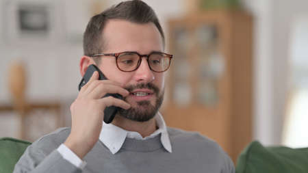 Middle Aged Man Talking on Phone at Home