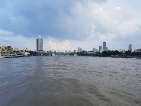 Choa Phraya River There is a backdrop of tall building, houses, people living along the river Фото со стока