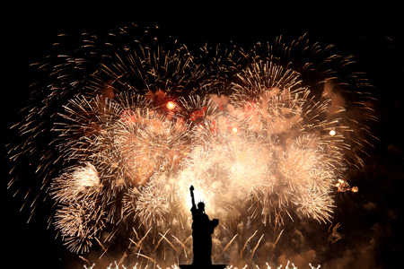 Silhouette statue of liberty on firework background