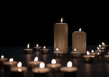 Candle lights, Christmas candles burning at night. Abstract candles background.