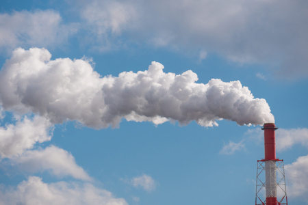 Air pollution from industrial smoke with blue sky. Фото со стока