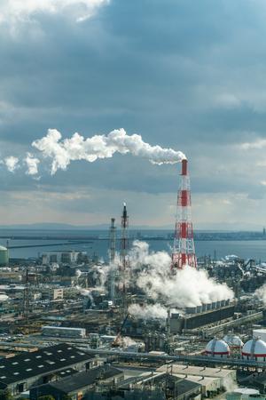 Industrial power plant and smokestack Фото со стока