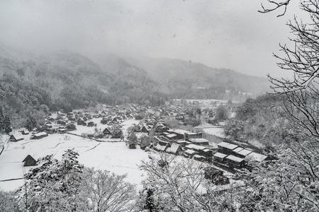 Shirakawa-go villages with snow falling at Japan. Stock fotó