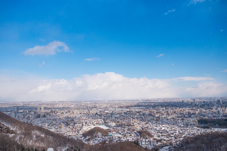 Top view of snow capped city and blue sky Stock Photo