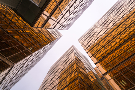 Low angle view of gold modern skyscraper business buildings Stock Photo