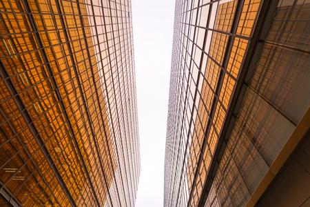 Modern gold corporate buildings in Hong Kong city.